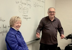 Jerry W. Jaromczyk is pictured here in his classroom recently as Brenda Gosney, president of the UK Alumni Association, surprised him with the news he had been named a 2014 Great Teacher.