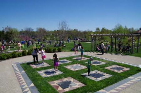 Pictured above, children and adults alike enjoy the activities provided at The Arboretum over Arbor Day weekend in the Kentucky Children's Garden.